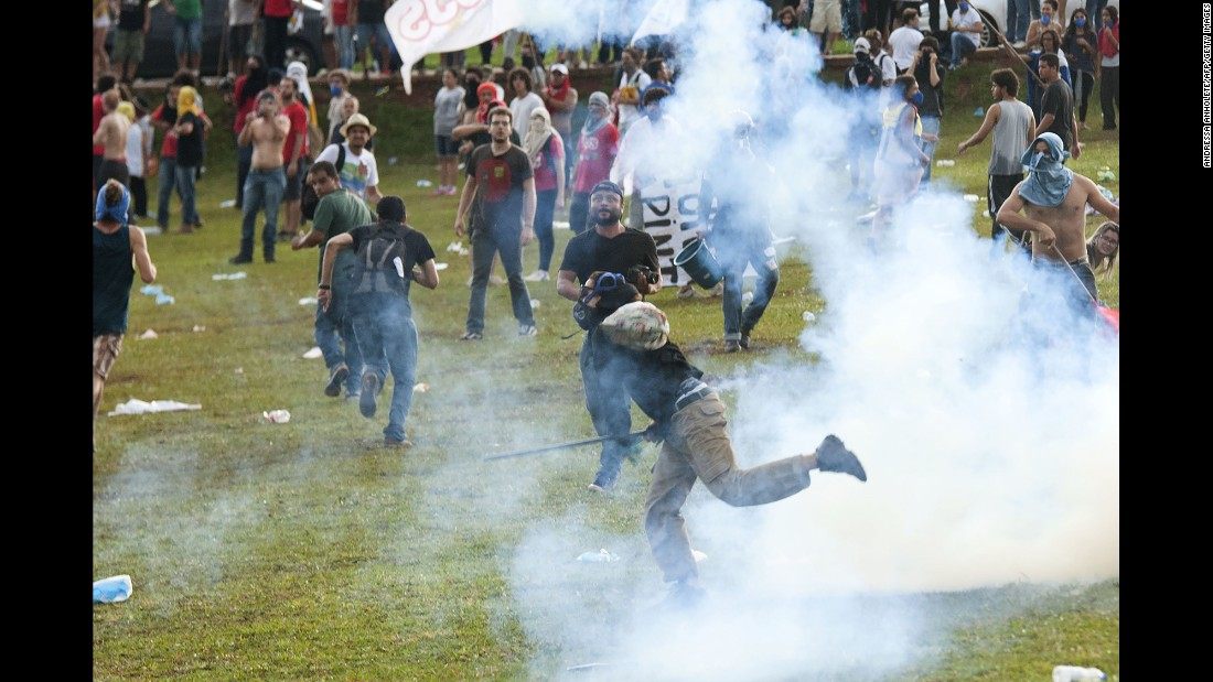 Students clash with police during a protest in front of Brazil's Congress on Tuesday, November 29. Lawmakers were about to vote on austerity measures that would freeze government spending for 20 years.