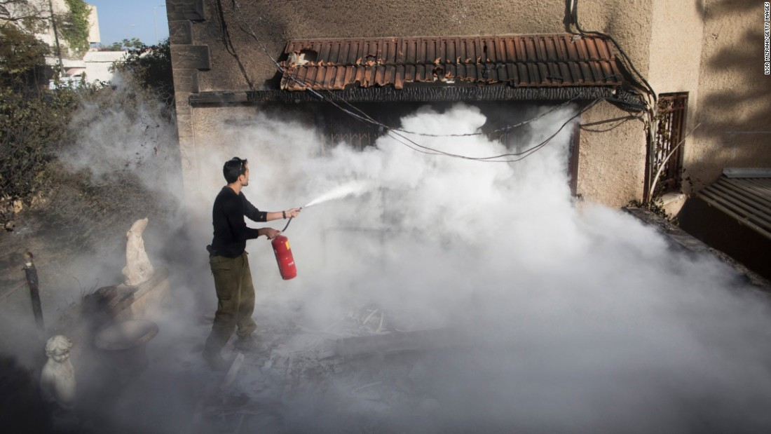 "A soldier helps extinguish a fire in Haifa, Israel, on Friday, November 25. Wildfires <a href=""http://www.cnn.com/2016/11/23/middleeast/gallery/israel-wildfires/index.html"" target=""_blank"">spread across Israel's third-largest city</a> and forced tens of thousands of people to flee their homes. <a href=""http://www.cnn.com/2016/11/24/world/gallery/week-in-photos-1125/index.html"" target=""_blank"">See last week in 29 photos</a>"