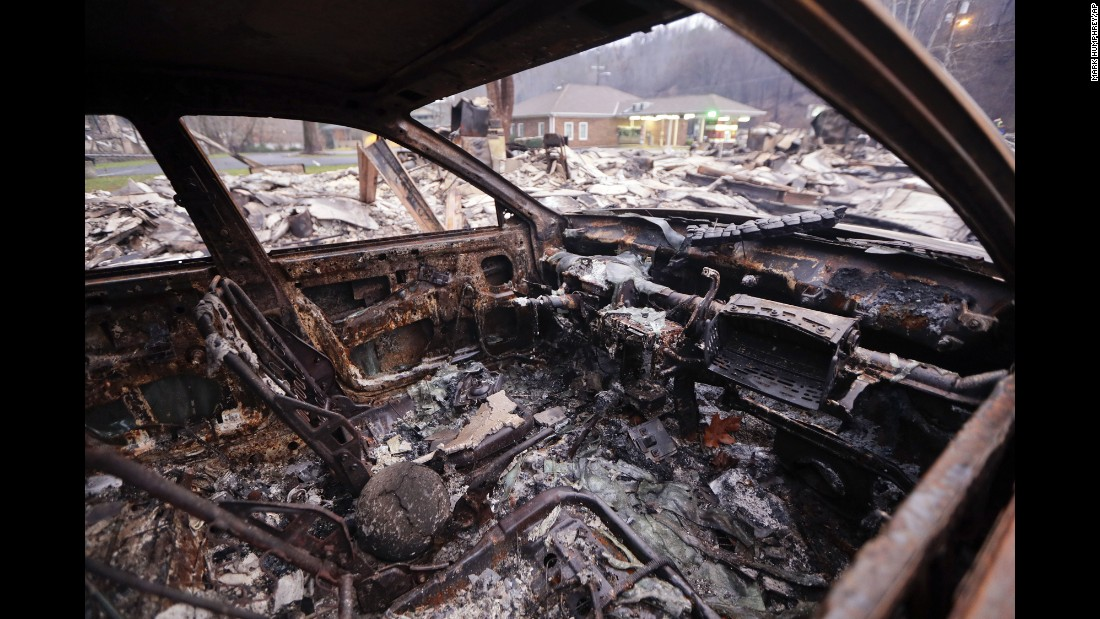 "A burned car sits in a parking lot Wednesday, November 30, after a wildfire swept through Gatlinburg, Tennessee. Gatlinburg city officials declared mandatory evacuations in several areas as firefighters <a href=""http://www.cnn.com/2016/11/28/us/southern-fires-gatlinburg-smokies/index.html"" target=""_blank"">battled at least 14 fires in and around the city. </a>More than 30 large wildfires <a href=""http://www.cnn.com/2016/11/16/us/gallery/southern-wildfires/index.html"" target=""_blank"">have left a trail of destruction</a> through North Carolina, South Carolina, Georgia, Tennessee, Alabama and Kentucky, according to the US Forest Service."