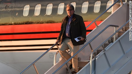 "Steve Bannon gets off the plane with US President-elect  Donald Trump arrives at Cincinnati/Northern Kentucky International Airport in Hebron, Kentucky, for the start of the ""USA Thank You Tour"" at the US Bank Arena in Cincinnati, Ohio, December 1, 2016."