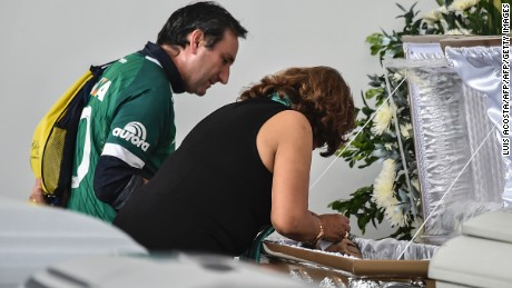 Roberto D'Machi, relative of Nilson Junior Folle one of the players of the Brazilian team Chapecoense Real killed in the accident, looks at the coffin at the Mortoury San Vicente in Medellin, on November 30, 2016.  Forensic authorities say they have managed to identify all victims of Mondays crash and hope to finish their work on Thursday. Of those identified, 52 are Brazilian and 5 Bolivians as well as a single Venezuelan and Paraguayan victim each. / AFP / LUIS ACOSTA        (Photo credit should read LUIS ACOSTA/AFP/Getty Images)