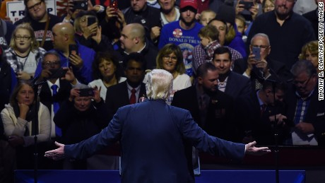 President-elect Donald Trump greets teh audience during the USA Thank You Tour at the US Bank Arena in Cincinnati, Ohio on December 1, 2016.