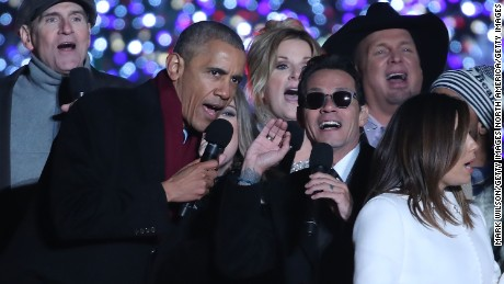 WASHINGTON, DC - DECEMBER 01: U.S. President Barack Obama sings Jingle Bells with Marc Anthony (C), James Taylor (L), Trisha Yearwood, Garth Brooks (R) and Eva Longoria (R, foreground) during the National Christmas Tree lighting ceremony, on December 1, 2016 in Washington, DC. This year is the 94th annual National Christmas Tree Lighting Ceremony.  (Photo by Mark Wilson/Getty Images)