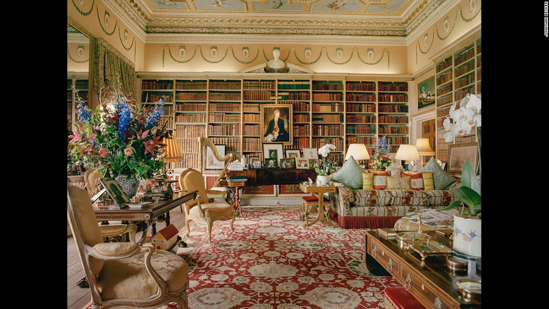 "The large library in Goodwood House, West Sussex, England. The house has been passed down to the Dukes of Richmond since 1697 and now sits with the son of the 10th Duke, Charles the Earl of March and Kinara. The Earl revived the house's sporting history by reopening its racetrack which now hosts hundred of thousands of visitors each year. ""Goodwood, in other words, is Downtown Abbey meets NASCAR,"" writes James Reginato in ""Great Houses: Modern Aristocrats."""