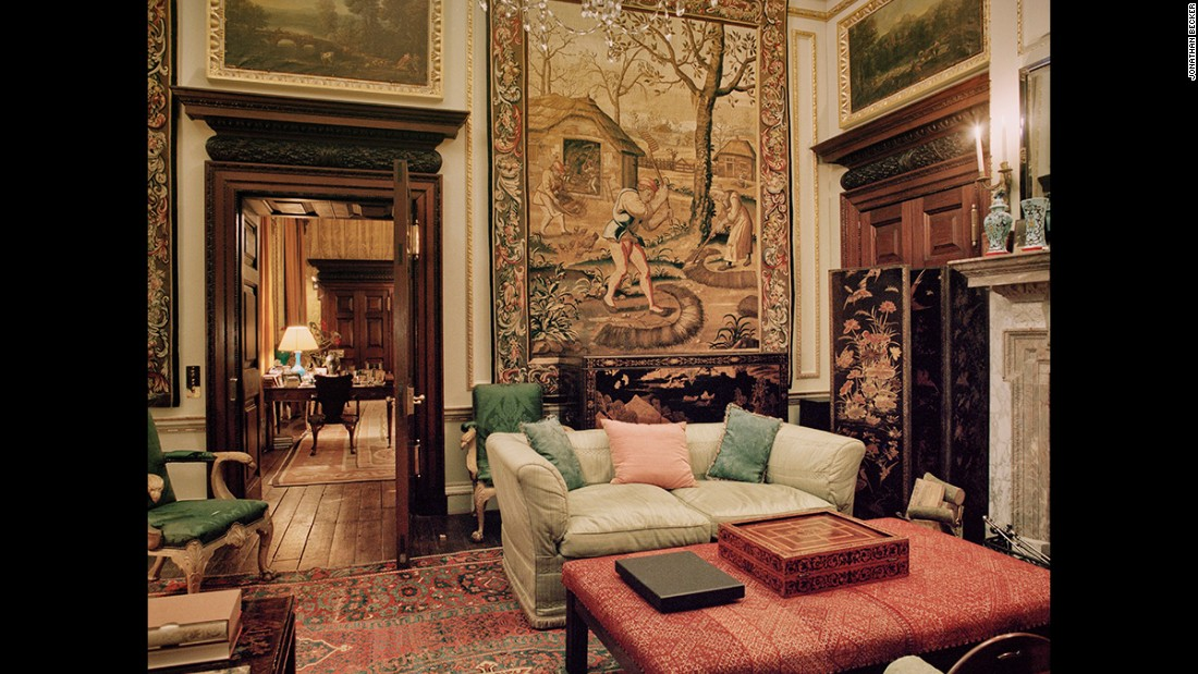 This tapestry-lined private sitting room is in Houghton Hall, a home built by Britain's first prime minister, Sir Robert Walpole, in 1722 in Norfolk. It once housed what was considered to be one of the finest collections of art in Britain until hundreds of the pieces were sold to Catherine the Great by the financially troubled heirs of the state. Houghton Hall's current owner and descendent of Walpole, David George Philip Cholmondeley the 7th Marquess of Cholmondeley, was able to secure a temporary return of 70 of the pictures, which hung in their original locations for six months.