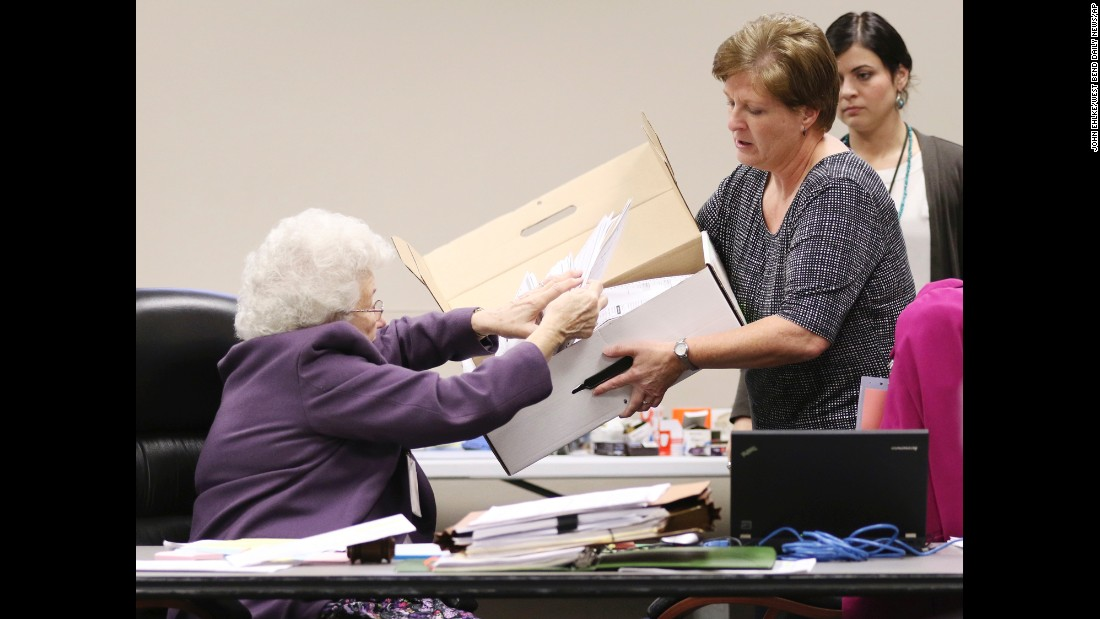 "County Clerk Brenda Jaszewski holds a box of absentee ballots from the town of Erin, Wisconsin, as Board of Canvass member Marilyn Merten reaches to take a ballot out during a <a href=""http://www.cnn.com/2016/11/25/politics/green-party-recount-wisconsin/"" target=""_blank"">statewide presidential election recount</a> Thursday, December 1, in West Bend, Wisconsin."
