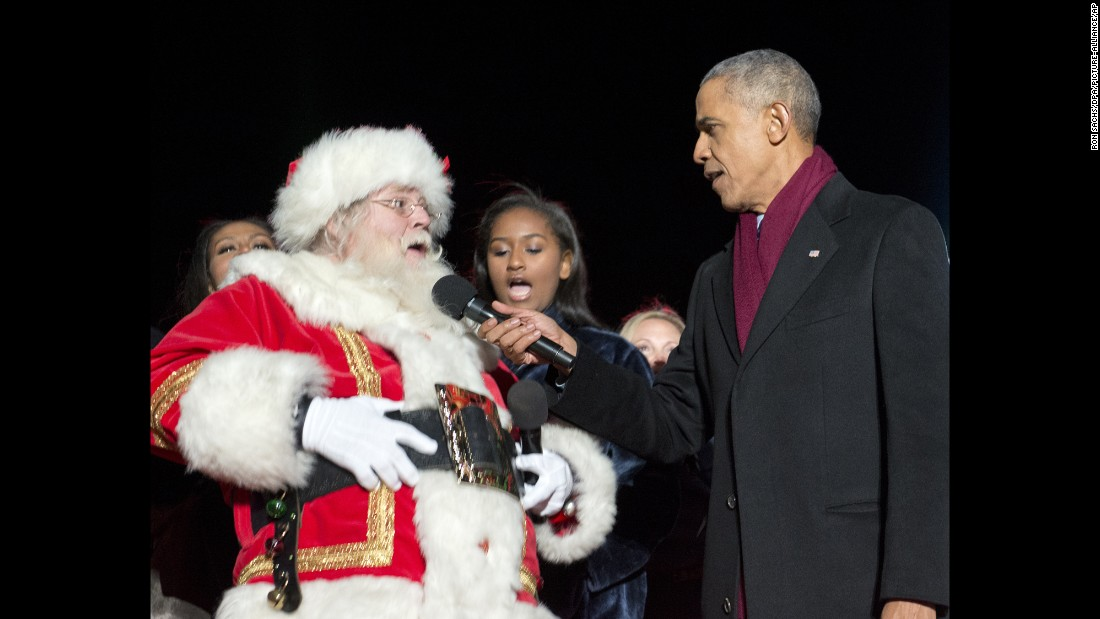 "United States President Barack Obama, right, holds the microphone for Santa Claus on December 1, as they attend the <a href=""http://edition.cnn.com/2016/12/01/politics/obama-christmas-tree/"" target=""_blank"">National Christmas Tree Lighting</a> in Washington, DC."