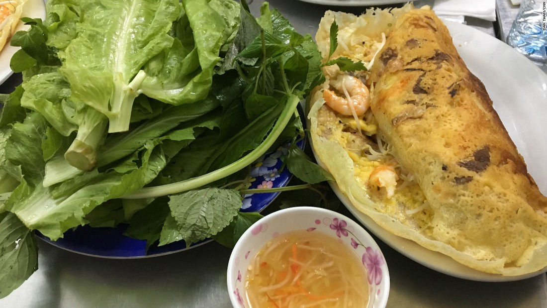 Turmeric powder, not eggs, lend this iconic southern dish its yellow color. Banh xeo is named for the sizzling sound its batter makes on the skillet.