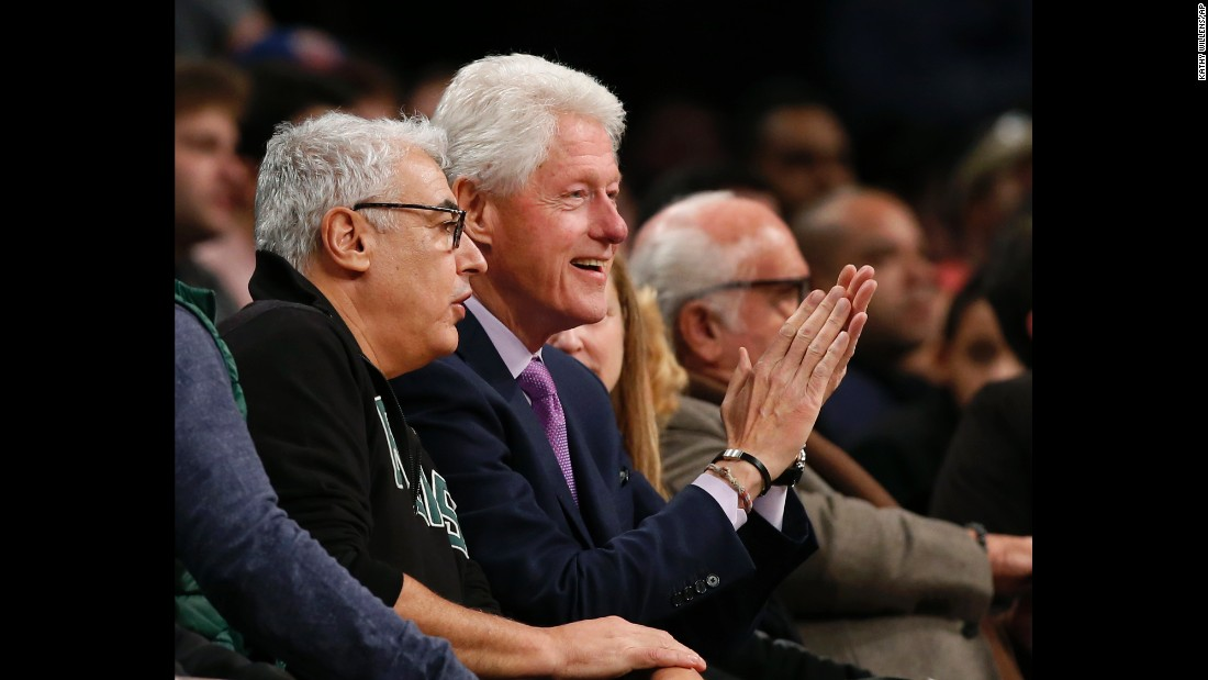 Milwaukee Bucks owner Marc Lasry, left, sits beside former President Bill Clinton, as the pair watch an NBA basketball game between the Brooklyn Nets and the Milwaukee Bucks, Thursday, December 1, in New York.
