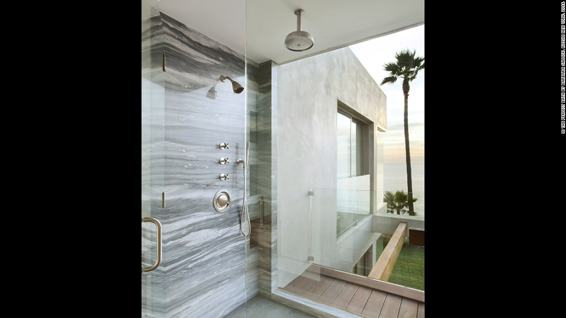 """I used layers of glass to separate the shower cabinet from an outdoor teak deck and from the rest of the bathroom. I also chose a stone for the shower wall that resembled the surface of the sea. That way there was a play on the perception of what was inside and what was outside,"" says designer Tim Clarke."