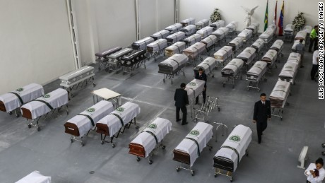 Funeral home employees prepare the coffins of Brazilian team Chapecoense Real players killed in Monday's plane crashin the Colombian mountains, on December 2, 2016 in Medellin, Colombia.  The disaster killed most of Brazilian football club Chapecoense Real and 20 journalists traveling with them to a major regional championship match. / AFP / LUIS ACOSTA        (Photo credit should read LUIS ACOSTA/AFP/Getty Images)