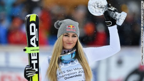 ST MORITZ, SWITZERLAND - MARCH 16:  Lindsey Vonn of the USA poses with the Women's World Cup Downhill Crystal Globe trophy after the Women's Downhill Race on March 16, 2016 in St Moritz, Switzerland.  (Photo by Matthias Hangst/Getty Images)