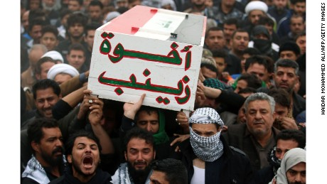 TOPSHOT - Iraqis mourn during the funeral procession of a fighter from the Hashed al-Shaabi (Popular Mobilisation) paramilitaries, who was killed in battles against Islamic State (IS) group jihadists to recapture the city of Mosul, during his funeral in the southern city of Basra on November 30, 2016. / AFP / HAIDAR MOHAMMED ALI        (Photo credit should read HAIDAR MOHAMMED ALI/AFP/Getty Images)
