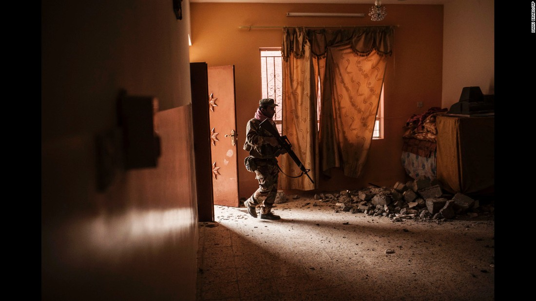 An Iraqi soldier searches a home for Islamic State militants after Iraqi forces retook the village of Al-Qasr, near Mosul, on November 30.