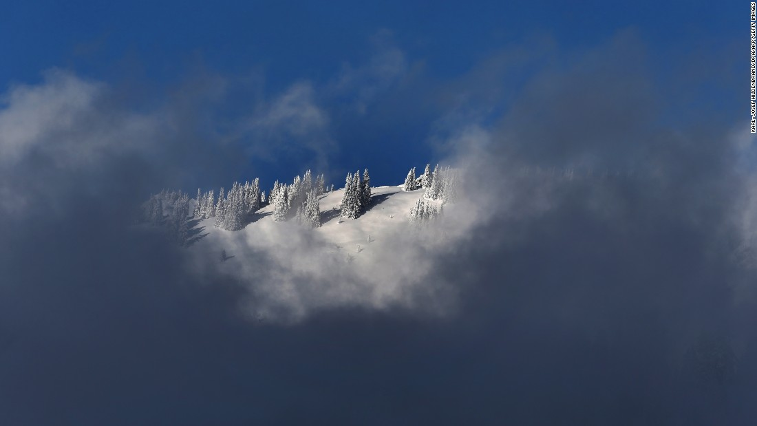 Clouds obscure a snow-covered mountain near Balderschwang, Germany, on November 12.