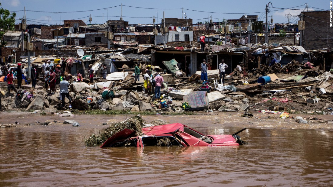 A car floats near the banks of South Africa's Jukskei River on November 10 after floodwaters ravaged the Alexandra Township area.