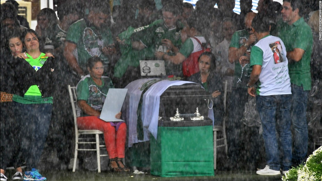 Relatives mourn over the coffin of one of the Chapecoense players at the stadium.