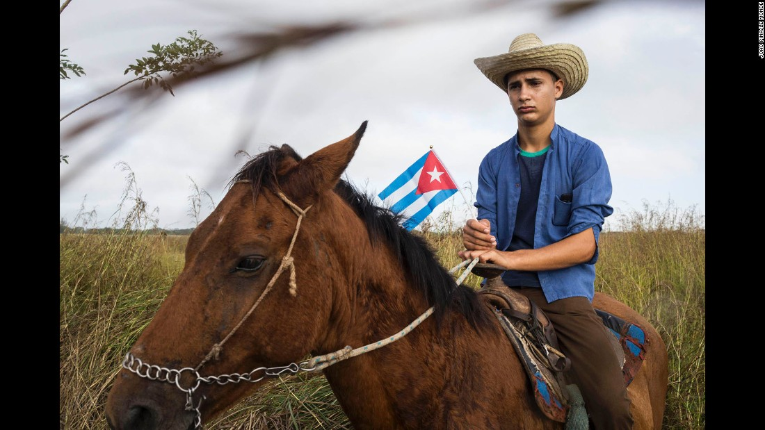 A man on horseback Saturday, December 3, waits on the side of the road for the caravan carrying the ashes of former Cuban President Fidel Castro, who died at age 90 on November 25.