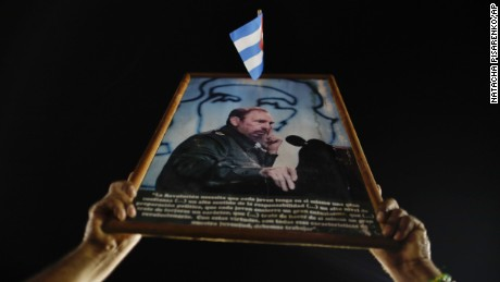 An image of Fidel Castro is held up high during the last memorial service in his honor at Antonio Maceo plaza in Santiago, Cuba, Saturday, Dec. 3, 2016. After a four-day journey across the country through small towns and cities where his rebel army fought its way to power nearly 60 years ago, Castro's remains arrived to Santiago where they will be buried the following day.