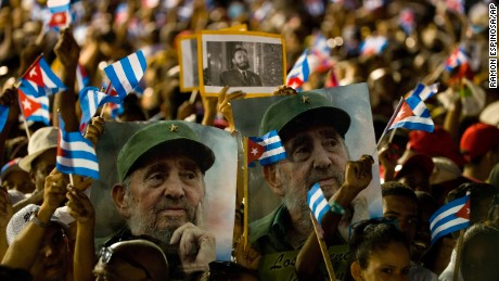 People wait for the start of a memorial honoring the late Fidel Castro at Plaza Antonio Maceo in Santiago, Cuba, Saturday, Dec. 3, 2016. After a four-day journey across the country through small towns and cities where his rebel army fought its way to power nearly 60 years ago, Castro's remains arrived to Santiago for burial.