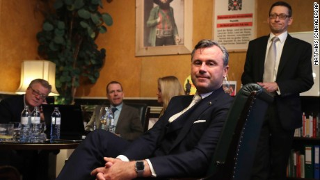 Norbert Hofer, center, candidate of the right-wing populist Freedom Party, poses for a photograph as he and his aides wait in his office in Austria's capital Vienna before the voting closes Sunday, December 4. Austria holds presidential elections on Sunday in a contest pitting a left-leaning contender against a right-winger supported by a populist anti-immigration party.