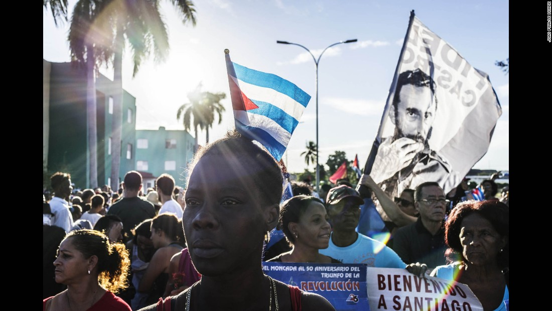 Cuban government supporters chant for Fidel Castro near the entrance of the cemetery on December 4.