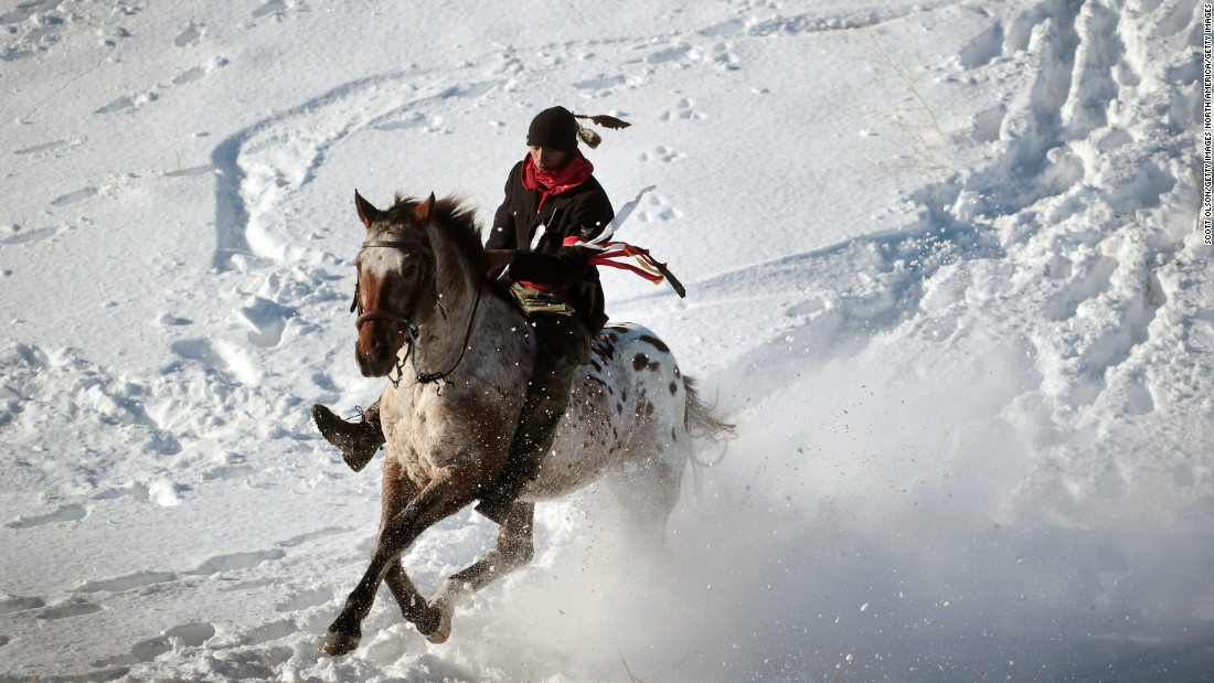 An activist rides down from a ridge on the edge of the Standing Rock Sioux Reservation on December 4.