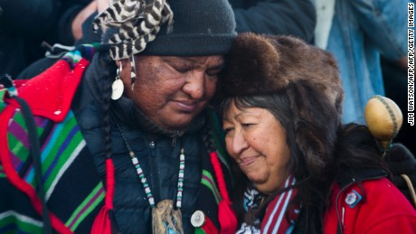 Activists celebrate at Oceti Sakowin Camp on the edge of the Standing Rock Sioux Reservation on December 4, 2016 outside Cannon Ball, North Dakota, after hearing that the Army Corps of Engineers has denied the current route for the Dakota Access pipeline.The US Army Corps of Engineers on Sunday announced they will no longer allow the Dakota Access Pipeline to cross under a lake on the Standing Rock reservation in North Dakota, marking a huge win for Native Americans and protesters who had long opposed the construction. / AFP / JIM WATSON        (Photo credit should read JIM WATSON/AFP/Getty Images)