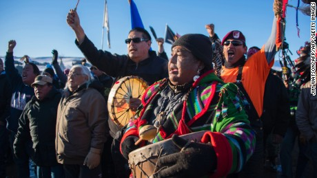 Activists celebrate at Oceti Sakowin Camp on the edge of the Standing Rock Sioux Reservation on December 4, 2016 outside Cannon Ball, North Dakota. 