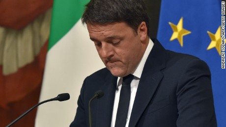 "CORRECTION - Italy's Prime Minister Matteo Renzi announces his resignation during a press conference at the Palazzo Chigi following the results of the vote for a referendum on constitutional reforms, on December 5, 2016 in Rome. ""My experience of government finishes here,"" Renzi told a press conference after the No campaign won what he described as an ""extraordinarily clear"" victory in the referendum on which he had staked his future.  / AFP / Andreas SOLARO / The erroneous mention[s] appearing in the metadata of this photo by Andreas SOLARO has been modified in AFP systems in the following manner: [December 5, 2016] instead of [December 4, 2016]. Please immediately remove the erroneous mention[s] from all your online services and delete it (them) from your servers. If you have been authorized by AFP to distribute it (them) to third parties, please ensure that the same actions are carried out by them. Failure to promptly comply with these instructions will entail liability on your part for any continued or post notification usage. Therefore we thank you very much for all your attention and prompt action. We are sorry for the inconvenience this notification may cause and remain at your disposal for any further information you may require.        (Photo credit should read ANDREAS SOLARO/AFP/Getty Images)"