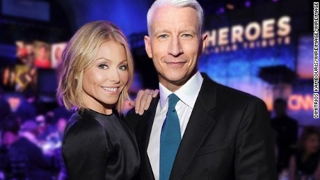 NEW YORK, NY - NOVEMBER 19:  Kelly Ripa and Anderson Cooper attend 2013 CNN Heroes: An All Star Tribute at The American Museum of Natural History on November 19, 2013 in New York City.  24079_014_1006.JPG  (Photo by Dimitrios Kambouris/WireImage) *** Local Caption *** Kelly Ripa; Anderson Cooper