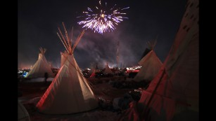 "Fireworks light the sky at the Oceti Sakowin Camp  near Cannon Ball, North Dakota -- following news that the Dakota Access Pipeline will be rerouted -- on Sunday, December 4. The Army Corps of Engineers has <a href=""http://www.cnn.com/2016/12/04/politics/dakota-access-pipeline/index.html"" target=""_blank"">denied the current route for the Dakota Access pipeline</a>."