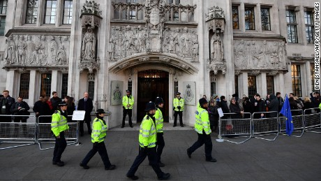 Police walk past the entrance to the Supreme court in London on the first day of a four-day hearing on December 5, 2016. The government of Prime Minister Theresa May will today seek to overturn a ruling that it must obtain parliamentary approval before triggering Brexit, in a highly-charged case in Britain's highest court. / AFP / BEN STANSALL        (Photo credit should read BEN STANSALL/AFP/Getty Images)