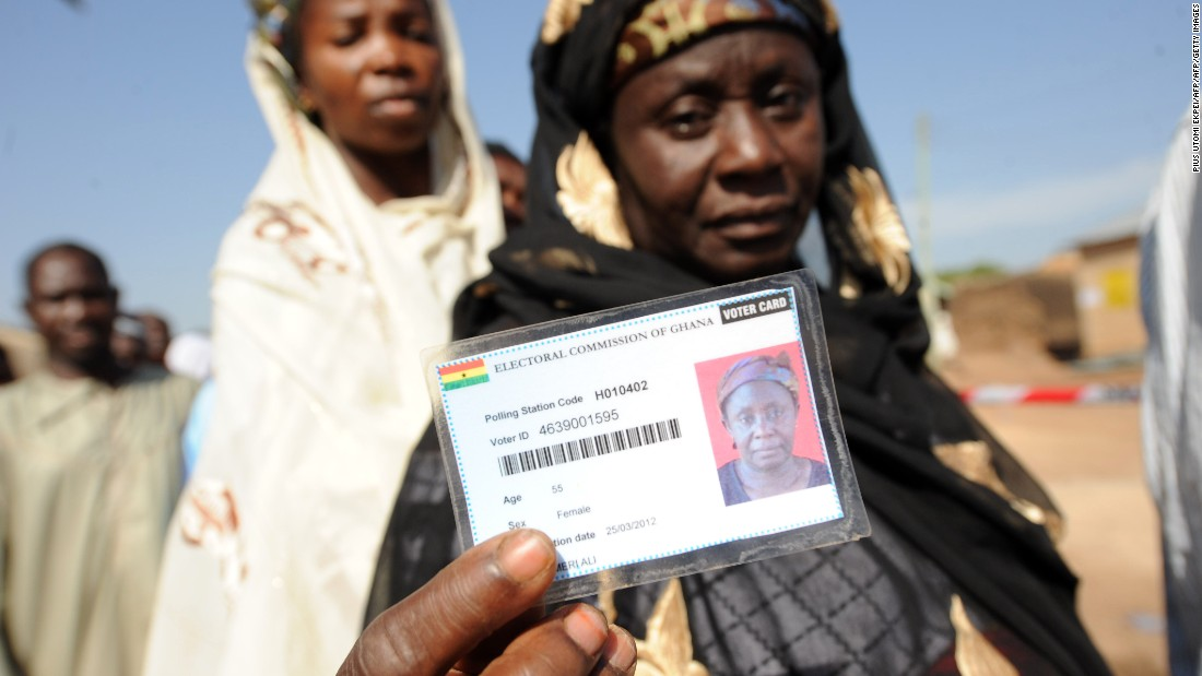 A woman shows her voter card prior to vote at Bole polling station on December 7, 2012.