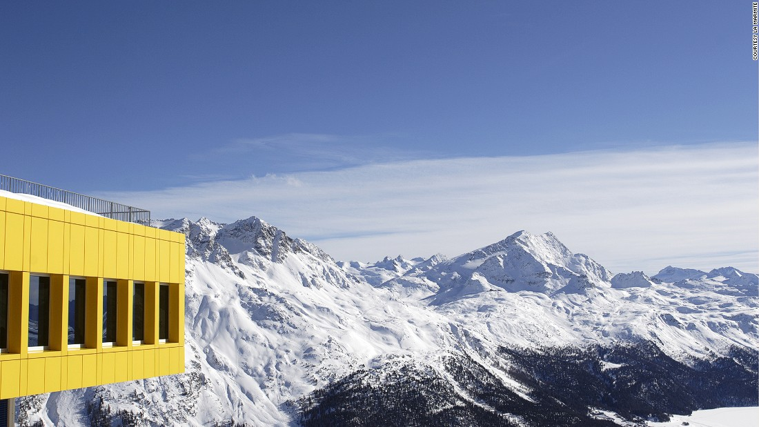 Named after the traditional cooking pot, La Marmite is a bold yellow cube atop Switzerland's St. Moritz.