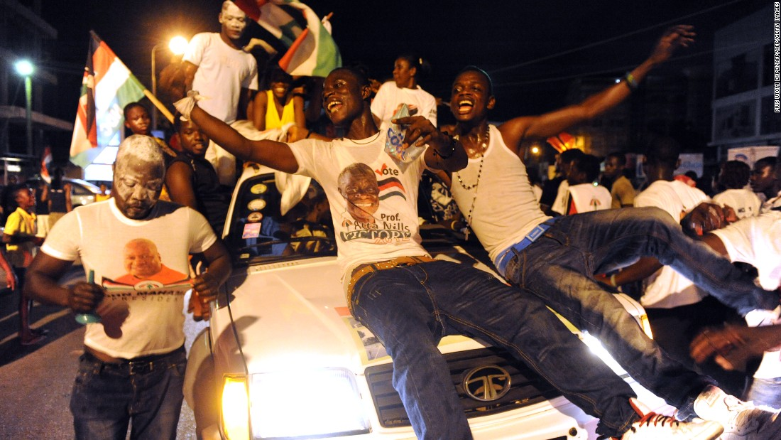 Supporters of the National Democratic Party celebrate in Accra the re-election of incumbent John Dramani Mahama after he was declared winner of of the presidential election.