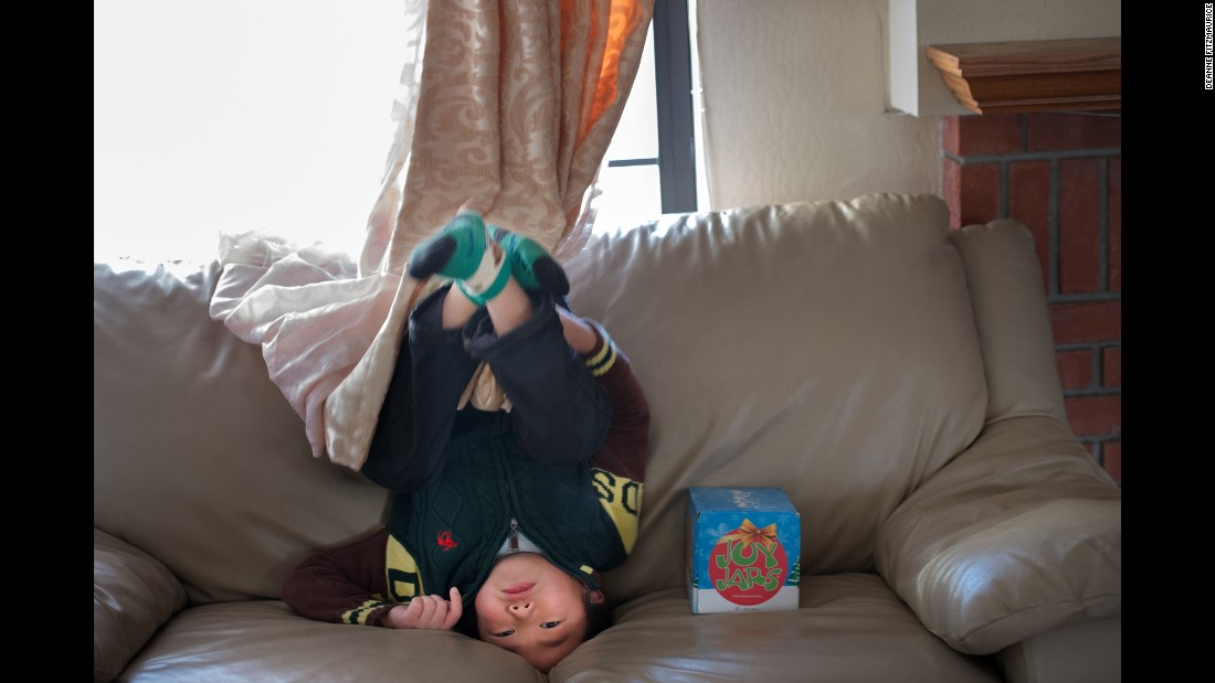 Edward Hu plays in his family's Alameda County, California, home. He and his older brother, Stephen, are two of the 200 to 300 children, virtually all boys, with Hunter syndrome in the United States. Hunter boys are missing one key metabolic enzyme, which affects every organ in their bodies, and causes gradual deterioration of their brain. Their mother, Pei, says their predicted lifespan is 10 to 20 years.