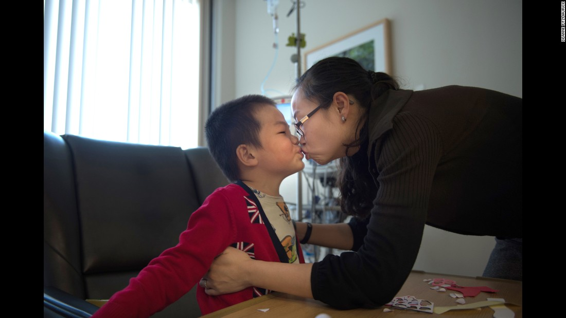 "Pei kisses her son, Edward. ""Maybe it's the impact you make that is ultimately the meaning of life,"" says Pei, who has become an advocate for her sons and other special needs children. ""If you think of it that way, it doesn't matter if your life is short or long. My boys have already made an impact."""