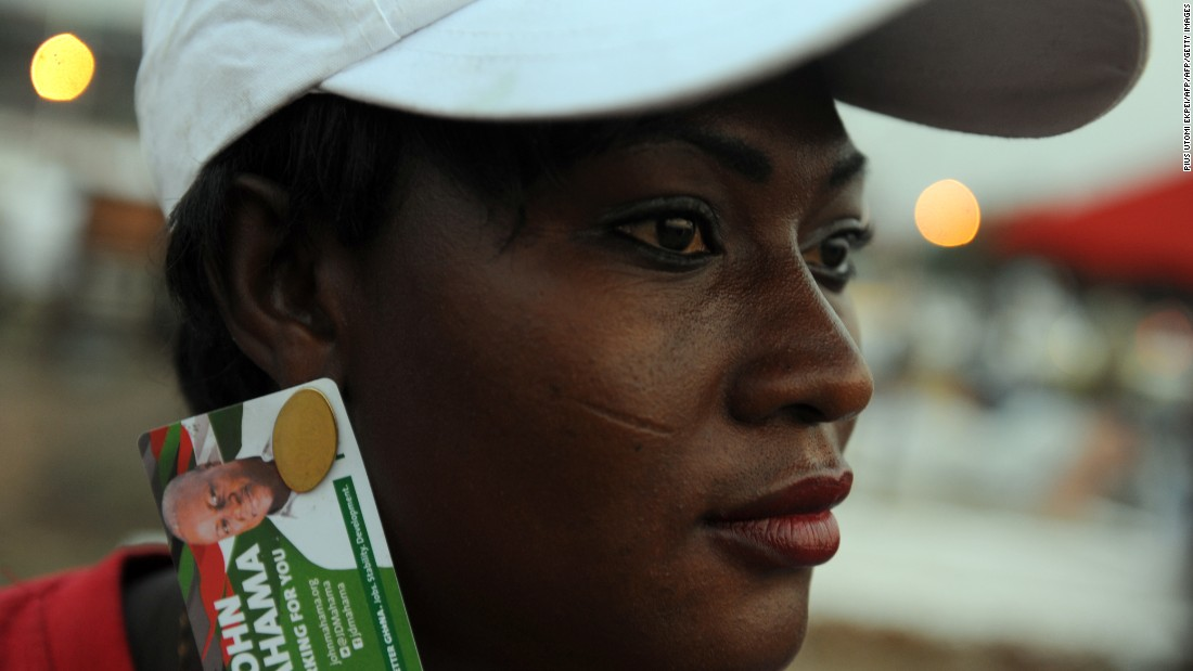 A party supporter wears earings designed in the names of Ghanaian President John Dramani Mahama