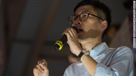"Former Umbrella Movement protest leader Nathan Law, 23, who became Hong Kong's youngest legislator in the recent citywide elections, speaks in front of the government headquarters in Hong Kong on September 28, 2016, on the second anniversary of the pro-democracy ""Umbrella Revolution"". The 2014 rallies brought parts of the city to a standstill demanding fully free leadership elections and other democratic reforms for semi-autonomous Hong Kong. Those demands were snubbed by Beijing, but since then former protesters have gained seats as lawmakers -- some are now pushing for a complete break from China.  / AFP / Anthony WALLACE        (Photo credit should read ANTHONY WALLACE/AFP/Getty Images)"