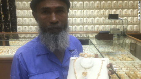 Turki al-Dajam, an executive at the Saudi sports channel, posted on snapchat videos showing Abdul Karim choosing a gold set. He also posted photos of the cleaner with his new gifts.