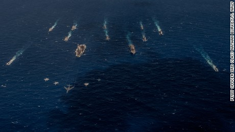 A B-1 bomber from the 34th Expeditionary Bomb Squadron leads a formation with fighters in front of U.S. Navy and Japanese surface vessels during Exercise Keen Sword 17, which took place Oct. 30 to Nov. 11, 2016, in the Pacific Ocean off the coasts of Japan, Guam and the Northern Mariana Islands. Keen Sword is a bilateral exercise between the Japanese Self-Defense Force and the United States designed to strengthen the Japan-U.S. alliance and increase combined combat readiness within the framework of the alliance. (U.S. Navy photo by Petty Officer 3rd Class Nathan Burke/Released)
