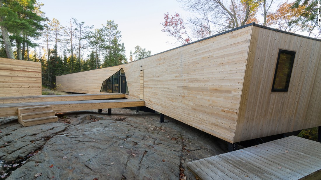 Also by Lazor, this house got its name as the two prefabricated modules kiss on the corner when installed. The open break forms a V-shaped outdoor room facing the water.
