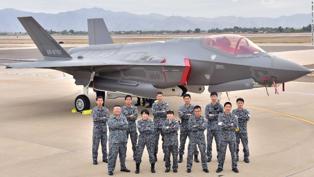 Japanese Air Self-Defense Force maintainers pose for a photo November 28, 2106, during the arrival of the first Japanese F-35A at Luke Air Force Base Arizona. The F-35 will give Japan a fifth-generation fighter.
