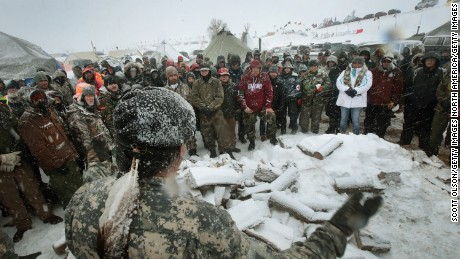 CANNON BALL, ND - DECEMBER 05:  Military veterans are briefed on cold-weather safety issues and their overall role at Oceti Sakowin Camp on the edge of the Standing Rock Sioux Reservation on December 5, 2016 outside Cannon Ball, North Dakota. Over the weekend a large group of military veterans joined native Americans and activists from around the country who have been at the camp for several months trying to halt the construction of the Dakota Access Pipeline. Yesterday the US Army Corps of Engineers announced that it will not grant an easement for the pipeline to cross under a lake on the Sioux Tribes Standing Rock reservation. The proposed 1,172-mile-long pipeline would transport oil from the North Dakota Bakken region through South Dakota, Iowa and into Illinois.  (Photo by Scott Olson/Getty Images)
