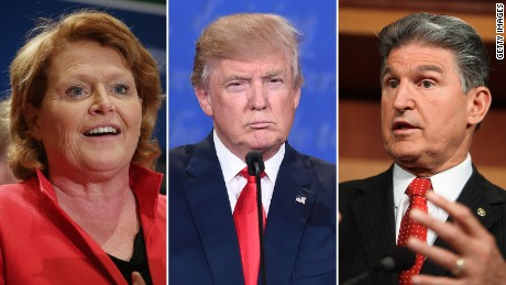 It's unclear whether Sen. Heidi Heitkamp (left) will serve in President-elect Donald Trump's administration, but Sen. Joe Manchin (right) ruled it out Tuesday.