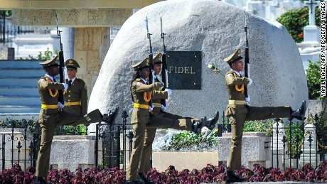 A guard of honour stays by the tomb of Cuban leader Fidel Castro at the Santa Ifigenia cemetery in Santiago de Cuba on December 4, 2016.  Fidel Castro's ashes were buried alongside national heroes in the cradle of his revolution on Sunday, as Cuba opens a new era without the communist leader who ruled the island for decades. / AFP / YAMIL LAGE        (Photo credit should read YAMIL LAGE/AFP/Getty Images)