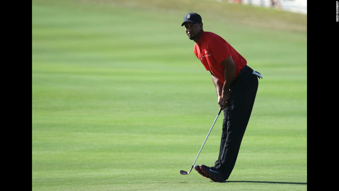 Tiger Woods watches his shot from the 14th fairway during the final round of the Hero World Challenge in Nassau, Bahamas, on Sunday, December 4. Woods finished 15th out of 17.