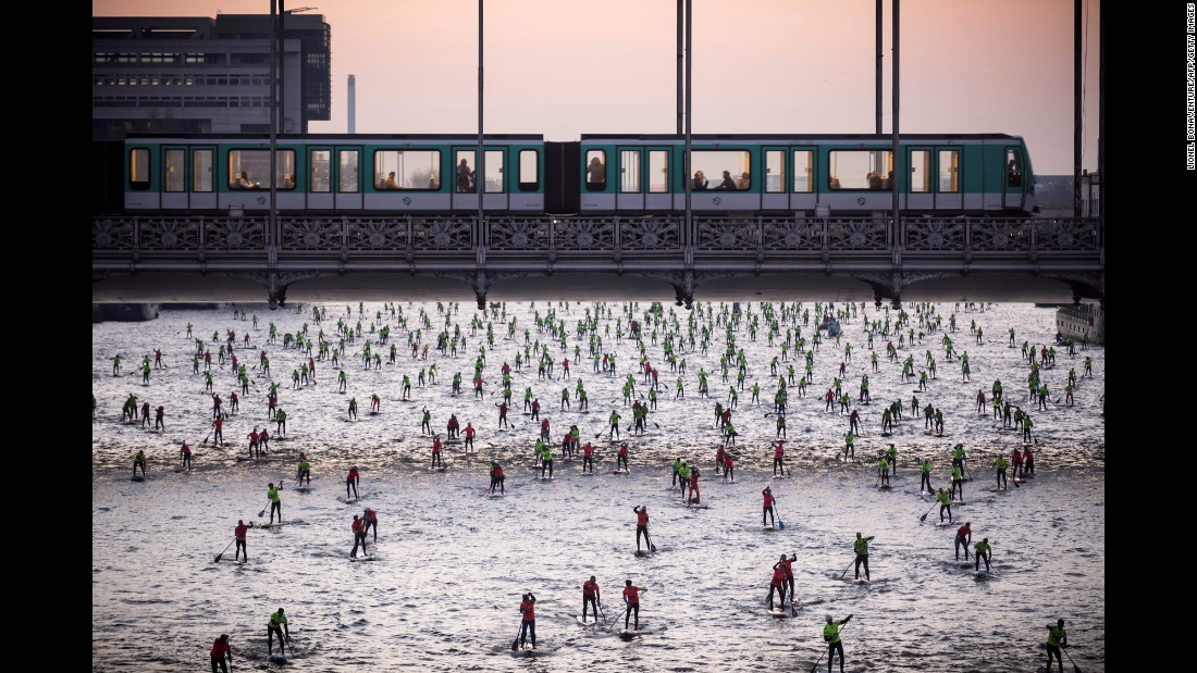People take part in the Nautic SUP Paris Crossing stand-up paddle competition on the Seine River in Paris on Sunday, December 4.