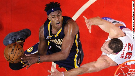 LOS ANGELES, CA - DECEMBER 4: Myles Turner #33 of the Indiana Pacers goes for a layup against Blake Griffin #32 of the Los Angeles Clippers during the second half of the basketball game at Staples Center December 4 2016, in Los Angeles, California. NOTE TO USER: User expressly acknowledges and agrees that, by downloading and or using this photograph, User is consenting to the terms and conditions of the Getty Images License Agreement. (Photo by Kevork Djansezian/Getty Images)
